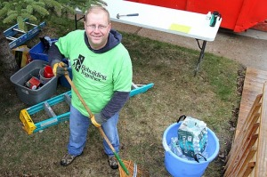 RT Day Volunteer with rake